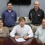 Harmon signs golf scholarship with EMCC