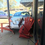 Car backs across square, crashes into Artifacts store