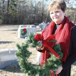 Locals place wreaths on headstones honoring veterans