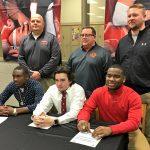 Three Wildcats sign football scholarships