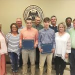 Supervisors award scholarships; agree to advertise for garbage truck