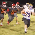Trojans run to another victory at Coffeeville